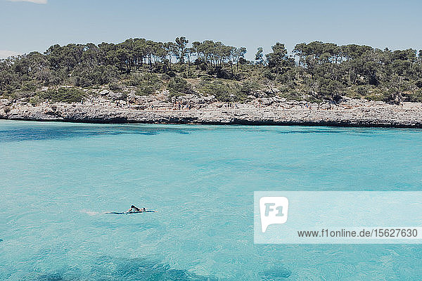 Man swims along shore  Mallorca  Balearic Islands  Spain