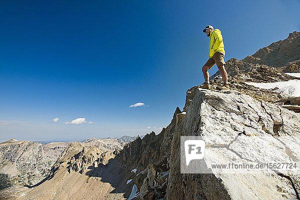 Male Hiker On Top Of Rock Exploring Grand Teton National Park