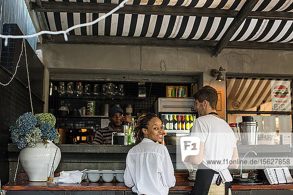 Servers wait at the juice bar at Market  a world-class restaurant at the foot of the Berea in Durban  South Africa. There is a kitchen and dinning inside  as well as a garden caf?? courtyard containing a ring of Leopard trees.
