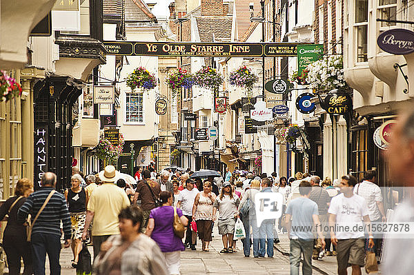 People walk the narrow streets of York,  England.