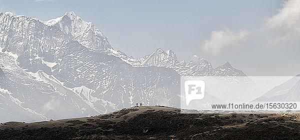 People trekking in the Himalayas near Machhermo  Solo Khumbu  Nepal