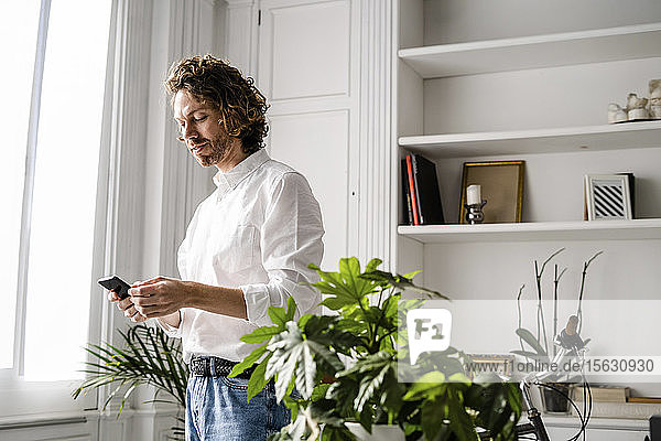 Man using cell phone at home