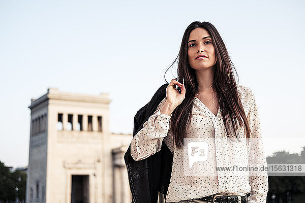 Portrait of young woman with long brown hair  Munich  Germany