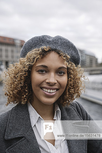 Portrait of happy young woman in the city  Berlin  Germany