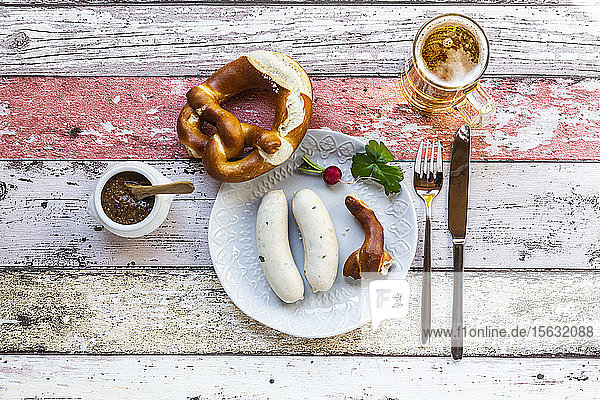 White sausage breakfast with pretzels  mustard and beer