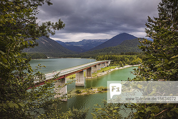 Bridge over Sylvenstein Lake against cloudy sky  Bavaria  Germany