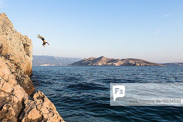 Croatia  Krk  man diving into sea