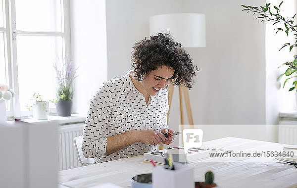 Smiling young woman working at table