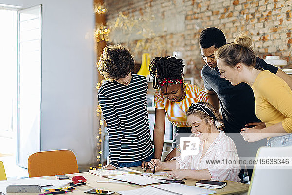 Young people working together at table
