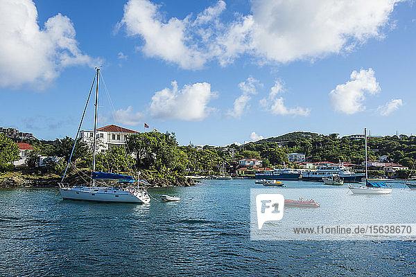 Boats on sea at Cruz bay against sky at Virgin Islands National Park  USA