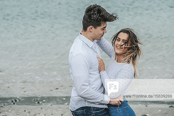 Portrait of a young couple being affectionate while at the beach; Wellington  North Island  New Zealand