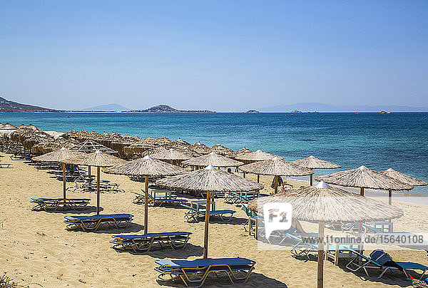 Resort with chairs and shelter along Plaka beach on the Mediterranean Sea; Naxos Island  Cyclades  Greece