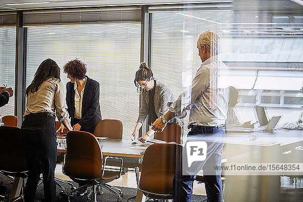 Legal professionals working at conference table in board room