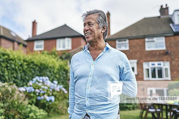 Portrait of happy man in his garden