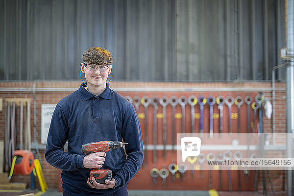 Portrait of apprentice timber mould maker in steelworks