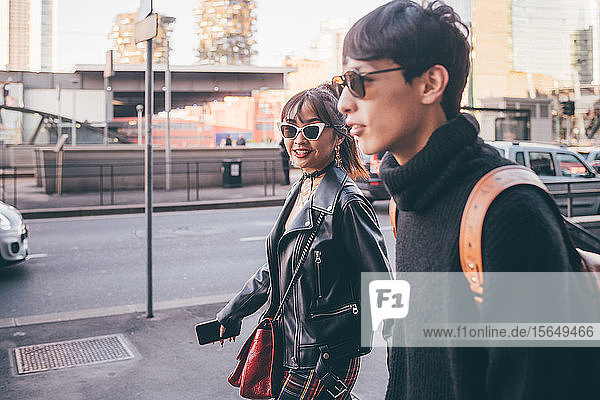 Young couple walking on street  Milan  Italy