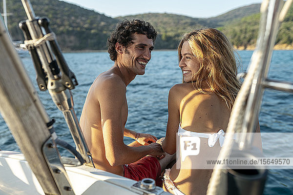 Affectionate couple on sailboat  Italy