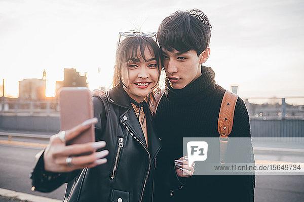 Young couple taking selfie on street  Milan  Italy