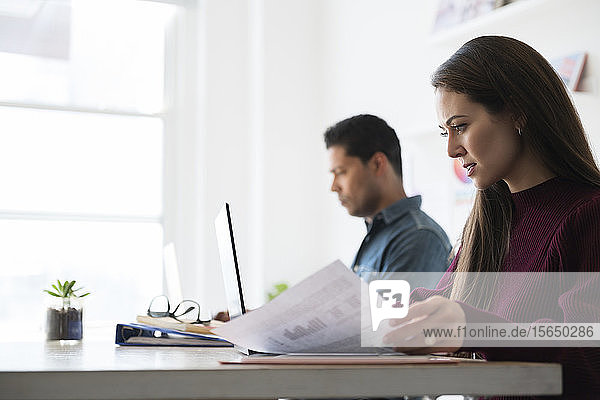 Coworkers working at office desk