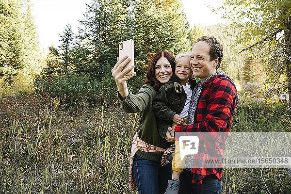 Family taking selfie in forest