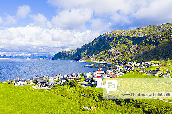 Aerial view by drone of Alnes Lighthouse and village  Godoya Island  Alesund  More og Romsdal County  Norway  Scandinavia