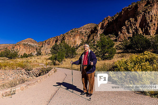 Old man walking through the Pueblo Indian Ruins in Bandelier National Monument  New Mexico  United States of America