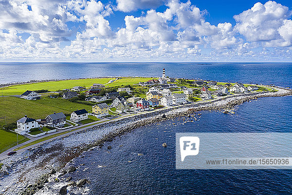 Aerial view by drone of the coastal village of Alnes  Godoya Island  Alesund  More og Romsdal County  Norway  Scandinavia