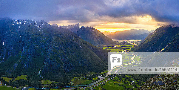 Aerial view of clouds at sunset over Romsdalen valley from Romsdalseggen ridge  Andalsnes  More og Romsdal county  Norway  Scandinavia