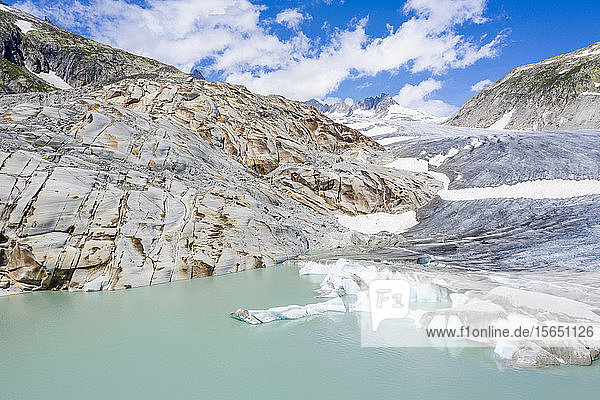 Rhone Glacier and glacial lake at its base in summer  aerial view  Gletsch  Canton of Valais  Switzerland
