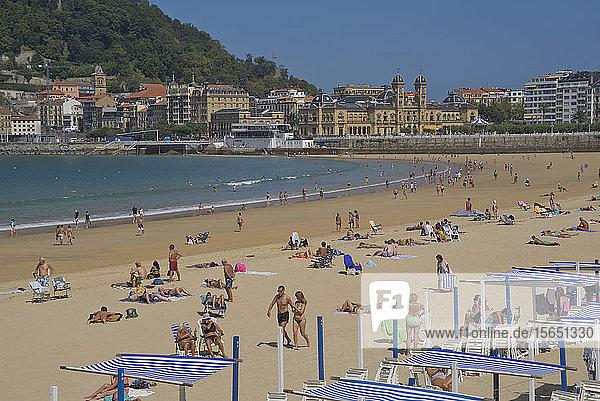 People enjoy the seaside at La Concha beach in San Sebastian  Basque Country  Euskadi  Spain  Europe