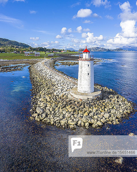 Front view of Hogsteinen Lighthouse  aerial view by drone  Godoya Island  Alesund  More og Romsdal County  Norway  Scandinavia