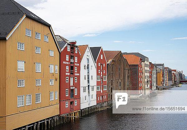 Old wooden warehouses on the Nidelva River in Trondheim  Trondelag  Norway  Scandinavia