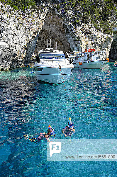Tourists snorkelling at the Blue Caves  Paxos  Ionian Islands  Greek Islands  Greece  Europe
