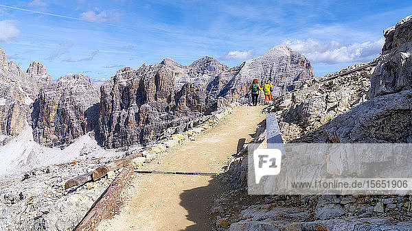Hikers walking in Monte Lagazuoi  Dolomite mountains  Dolomites  Italy  Europe