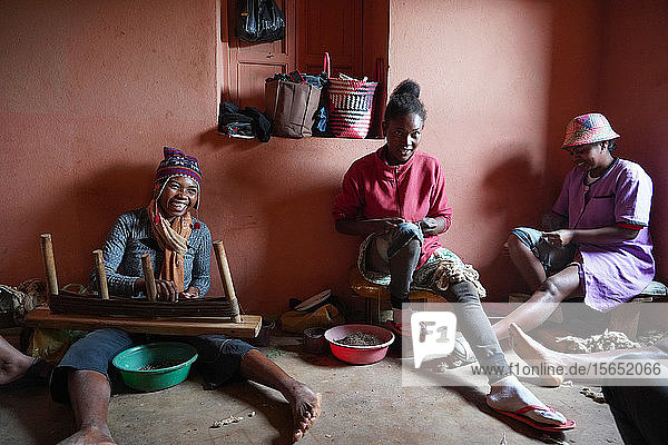 Silk weaver at work  Soatanana  Fianarantsoa province  Ihorombe Region  Southern Madagascar  Africa
