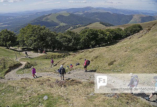 Christian pilgrims walking the Camino de Santiago (St. James' Way) route in Spain
