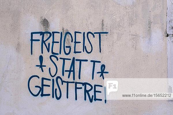 Freigeist statt Geistfrei text written with graffiti on wall