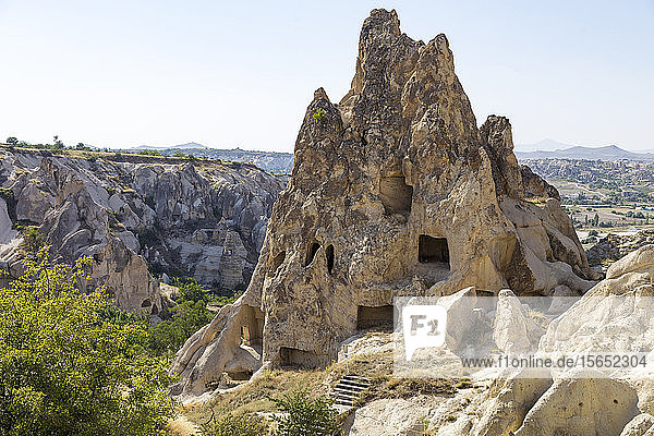 Carved rock formations against clear sky at Goreme Open Air Museum  Cappadocia  Turkey