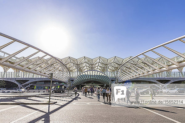 People at Gare Do Oriente against clear sky during sunny day  Lisbon  Portugal