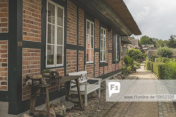 Footpath by houses in Gothmund village  Lübeck  Germany