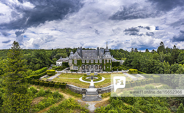 Aerial view of Manoir de Lébioles amidst trees against cloudy sky  Spa  Belgium