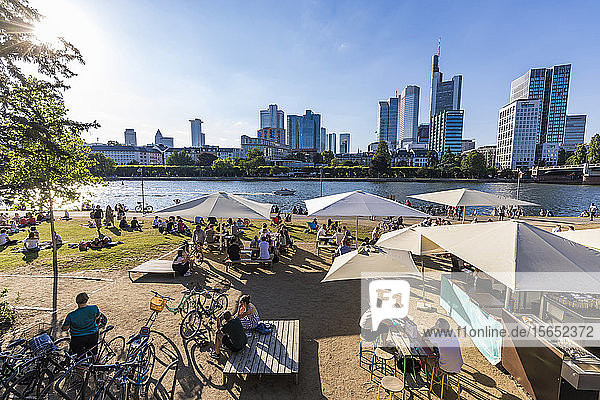 People at Maincafé against sky during sunny day in Frankfurt  Germany