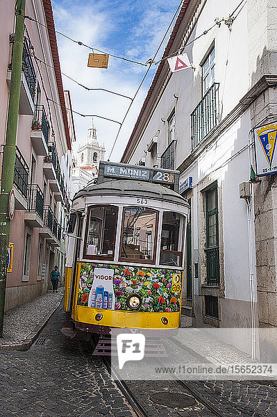 Tram in Alfama street of Lisbon  Portugal