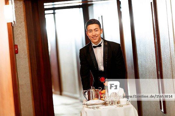 The hotel waiter