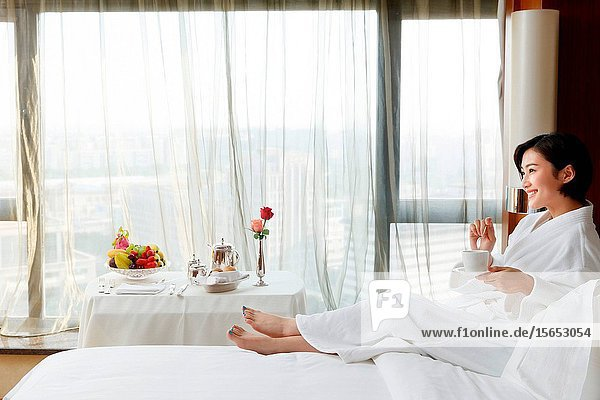The young woman in a hotel room for coffee
