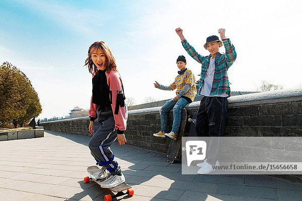 Young people skateboarding