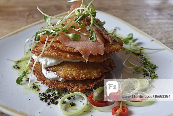Potato pancakes with smoked salmon and curd  Grey restaurant  Pilies Street 2  Vilnius  Lithuania  Europe.