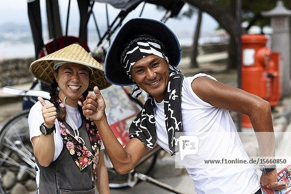 Portrait of a smiling Japanese rickshaw puller Miyajima island Japan Asia.