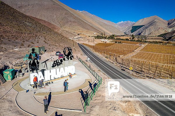 Construction workers build a welcoming artwork and sign to the Elqui Pisco Valley  Coquimbo  Chile.