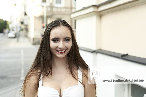 Portrait of young woman looking at camera. Munich  Germany.